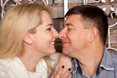 Man and woman gazing in to each others eyes Stock Photos
