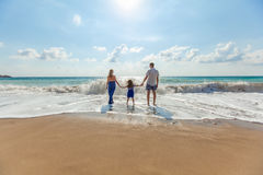Man and Woman With Girl in Beach Stock Photography