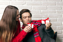 Man and Woman Give Each Other Gifts stock photo
