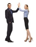 Man and woman giving a high five Royalty Free Stock Photos