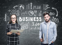 Man and woman in glasses, business idea Stock Photography
