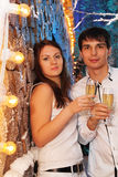 Man and woman with glasses of champagne stand Stock Photos