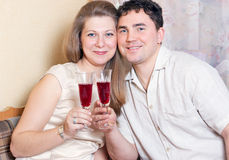 The man and the woman with glasses of wine Royalty Free Stock Photography