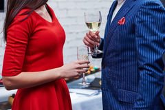 Man and woman with glasses of wine at party Stock Photos