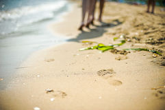 man and a woman go on sand Royalty Free Stock Image
