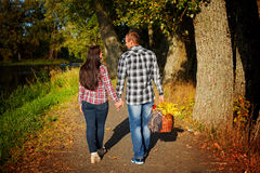 Man and woman  go for walk on autumn picnic. Couple walking Royalty Free Stock Images