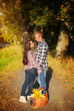 Man and woman  go for walk on autumn picnic. Couple walking in a Royalty Free Stock Photography