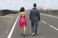Man and woman going away on the road Stock Images