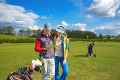 Man and woman at golf Royalty Free Stock Photos