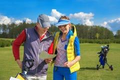 Man and woman at golf Stock Photo