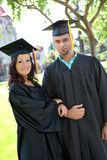 Man and Woman Graduates Royalty Free Stock Photo