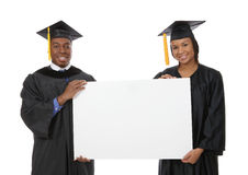 Man and Woman Graduation Sign Royalty Free Stock Photo