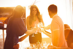 Man and woman greeting girl in restaurant Royalty Free Stock Photo