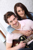 Man and woman with guitar. Young women and young men with guitar Stock Photos