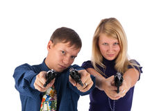 Man and woman with guns Stock Image