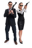 Man and woman with guns. Businessman and businesswoman with guns isolated on white background Royalty Free Stock Photos