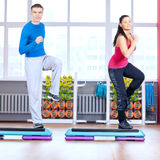 Man and woman at the gym doing stretching Stock Photography
