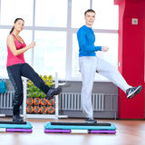 Man and woman at the gym doing stretching Royalty Free Stock Photos