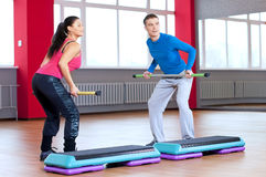 Man and woman at the gym doing stretching Stock Image