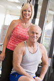 Man And Woman At Gym Together Stock Photo
