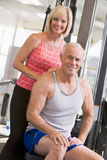 Man And Woman At Gym Together Royalty Free Stock Images