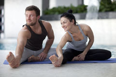 Man and woman at the gym. Man and women doing sports together Stock Photos