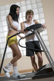 Man and woman in the gym Royalty Free Stock Photo