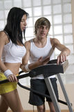 Man and woman in the gym Stock Images