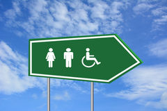 Man woman and handicap sign. A sign with male, female and handicapped symbols for bathroom or other purposes Stock Photo