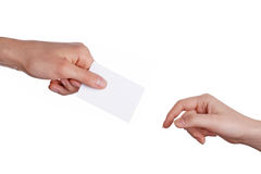 Man and woman hands. Man hand give card to woman hand. Isolated white stock photo