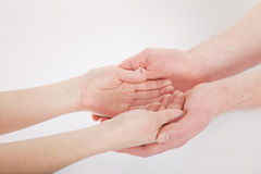 Man and woman hands. On white Stock Photography