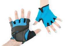 Man and woman hands in cycling gloves isolated. Man and woman hands in blue cycling or fitness gloves. Isolated on white stock photos
