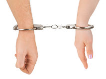 Man and woman hands and breaking handcuffs. Isolated on white background Stock Photography