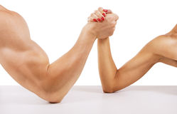 A man and woman with hands clasped arm wrestling Royalty Free Stock Photos