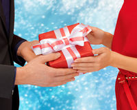 Man and woman hands with gift box Royalty Free Stock Photography