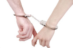 Man and woman hands in handcuffs. Stock Images