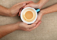 Man and woman hands hold empty  latte coffee cup Royalty Free Stock Photo