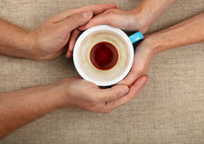Man and woman hands hold full black coffee cup Royalty Free Stock Photos