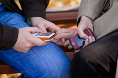 Man and woman hands hold mobile phones Stock Photo