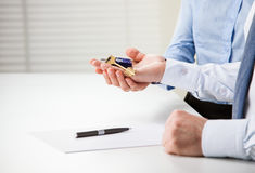 Man and woman hands holding keys from a new house Royalty Free Stock Photography