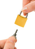 Man and woman hands with key and lock Stock Photography
