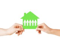 Man and woman hands with paper house Stock Images