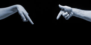 Man and woman hands pointing on empty copy space on black background Royalty Free Stock Images