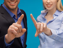 Man and woman hands pointing at something Stock Images