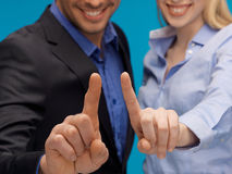 Man and woman hands pointing at something Stock Photos