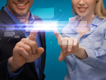 Man and woman hands pointing at virtual screen Stock Photos