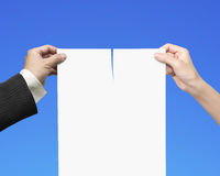 Man and woman hands tearing contract paper with blank Royalty Free Stock Image