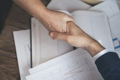 Man and woman hands on working table stock images