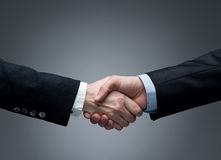 Man and woman handshake Stock Images
