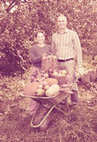 Man and woman  with  harvest Stock Photo
